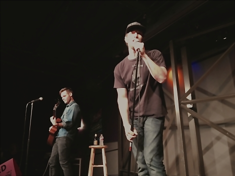 "Josh Wolf is singing his own version of 'Happy Birthday' to a fan as Jeff ""Jiffy"" Wild plays his guitar."