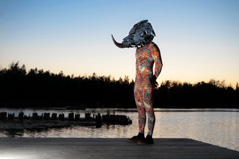 Local artist Raul De Lara showcases his work from Oxbow this summer. He wears a unitard and a mask he created at the program. Photo courtesy of Raul De Lara.