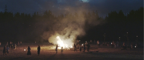 "Father Jay's group holds a bonfire late at night in ""One Eyed Girl."" Photo courtesy of Projector Films."