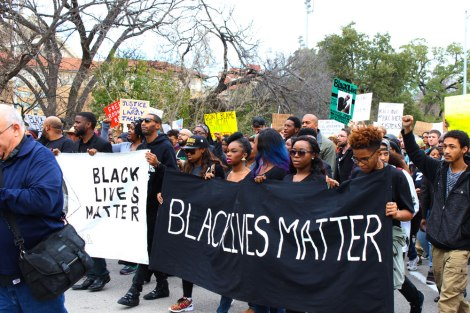 Protestors march to the Capitol. Photo by Dana Summers