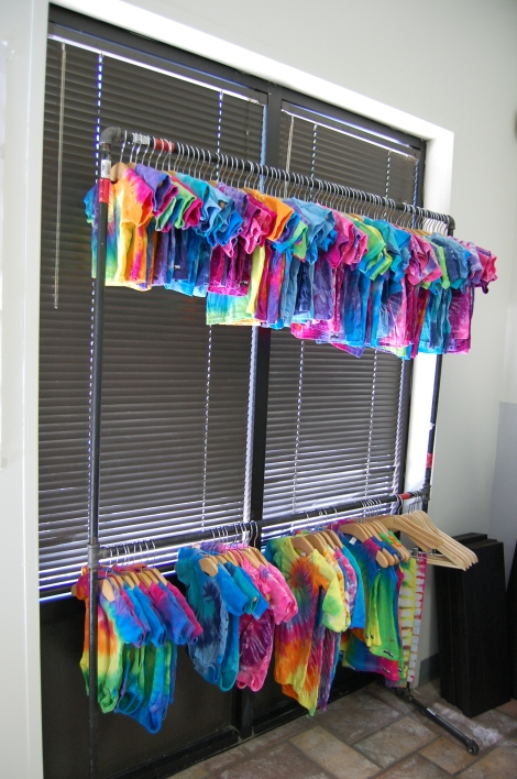 Baby onesies in various tie dye colors hang in front of the Austin Tie Dye Co. shop. Photo by ChinLin Pan