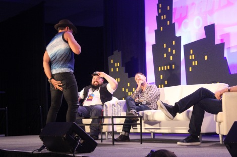 Manu Bennett shakes his butt and grabs it in the middle of the Lord of the Rings/The Hobbit panel with Billy Boyd and John Noble at Alamo City Comic Con.