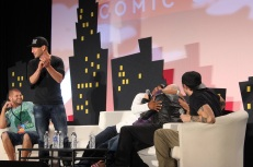 """A fan asked for a hug from """"The Walking Dead""""'s Jon Bernthal. In response, Michael Rooker drags her to the stage for a hug, which Lawrence Gilliard Jr. also joins in on. What a happy fan! Photo by Catherine Gutierrez"""