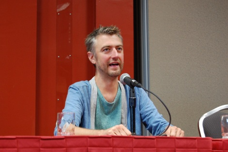 "Sean Gunn answers a question at the ""Guardians of the Galaxy"" panel"