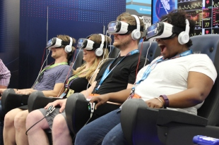 Trade Show participants ride the Virtual Reality Rollercoaster at the Gillette Clinical Pressure Chamber powered by Discovery-VR / Photo by Dana Summers