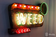 """""""Weed"""" by artist Todd Sanders: Weed Sign. Styled after the old motel signs, the """"IL"""" in """"ILLEGAL"""" turns off and on in the manner of """"NO"""" VACANCY. / Photo by Ray Gilford"""